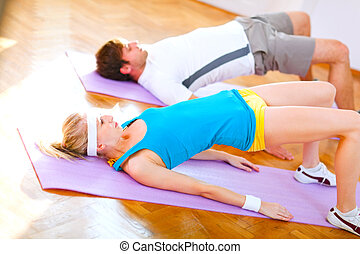 Healthy couple in an aerobics class