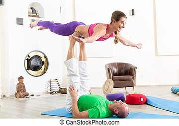 Healthy couple performing acroyoga