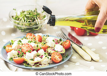 Healthy delicious tasty salad with tomatoes, radishes,...