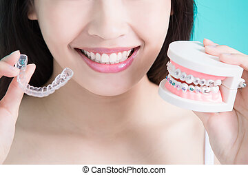 healthy dental concept - woman choicce different brace on...