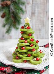 Healthy dessert idea for kids party - funny edible kiwi pomegranate Christmas tree
