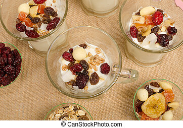 Healthy dessert prepared with yoghurt and dried fruit