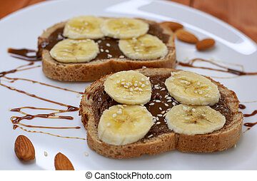 healthy dessert with chocolate paste and bananas