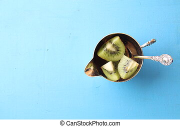 Healthy dessert with Kiwi fruit . Food background. Top view Copy space.
