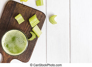 Healthy detox celery juice in a glass on the white table
