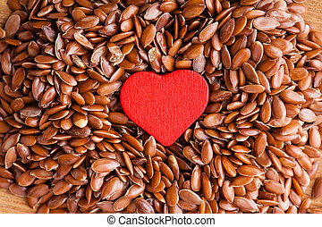 Healthy diet. Flax seeds linseed as food background and red...
