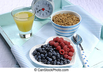 Healthy diet high dietary fiber breakfast with bowl of bran...
