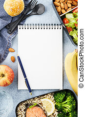 Healthy diet lunch boxes with food and empty notepad.