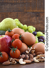 Healthy Diet with fresh fruit, eggs, nuts and vegetables. - ...