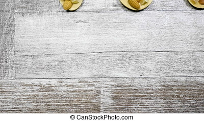 Healthy different type of nuts and sweet in wooden spoon on...