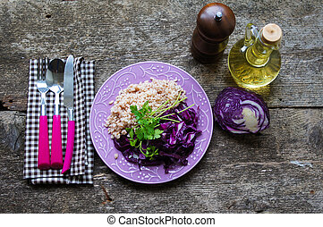 Red cabbage salad and idian rice on the table