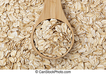 Healthy Dry Oatmeal in a wooden spoon - A Healthy Dry Oat...