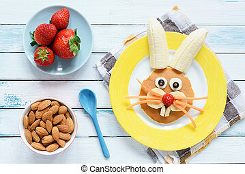 Healthy Easter Breakfast For Kids. Easter Bunny Shaped Pancake With Fruits