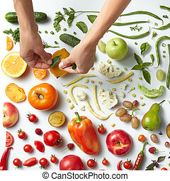 Healthy eating background - Woman's hand putting different...