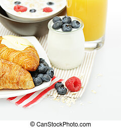 Healthy eating - breakfast with croissant, berries and orange juice