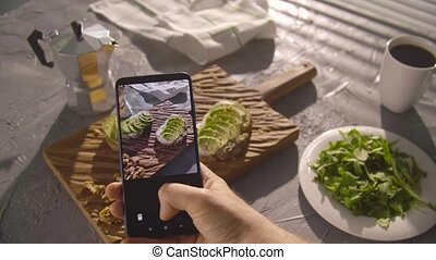 Healthy eating concept. Hand taking photo sandwich with ...