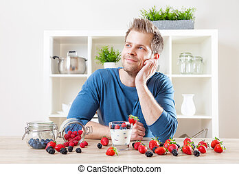 Man with delicious yogurt with fresh berries