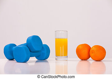 healthy eating concept. Small dumbbells. Apple juice. The skipping rope. Measuring tape waist. Oranges on a white background. healthy lifestyle. sport.