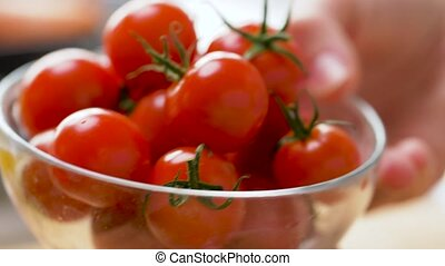red ripe cherry tomatoes in glass bowl - healthy eating, ...