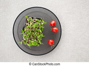 Green haricot sprouts and cherry tomatoes