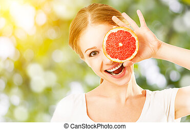 Happy funny girl with grapefruit