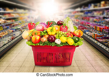 Heap of fresh vegetables in the basket in the store