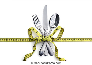 Healthy eating or dieting concept - A set of silverware tied...