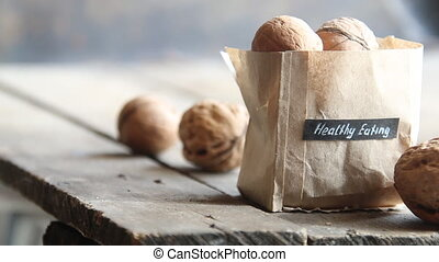 healthy eating text and walnuts on rustic old wooden table