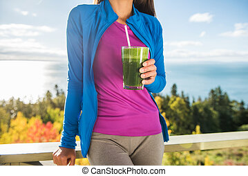 Healthy eating woman drinking green smoothie detox
