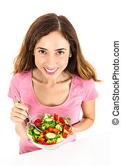 Healthy eating woman with a bowl of salad