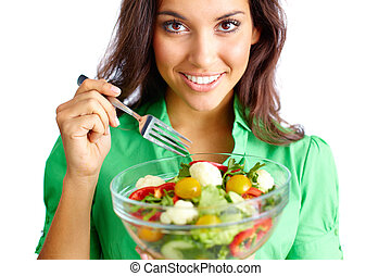 Healthy eating - Young female holding bowl with vegetable...