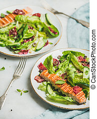 Healthy energy boosting spring salad with grilled salmon, orange, quinoa