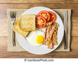 Healthy English Breakfast With Fried Egg, Toast, Bacon And...