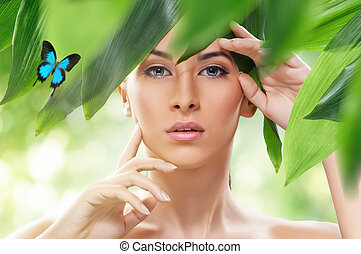 healthy face - beautiful girl and green leaves