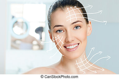 healthy face - beauty woman on the bathroom background