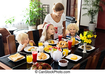 Healthy family breakfast for mother and kids.
