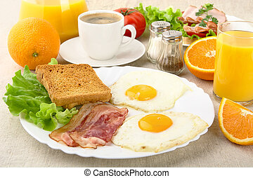 Healthy fatty breakfast with cup of coffee with bacon,eggs...