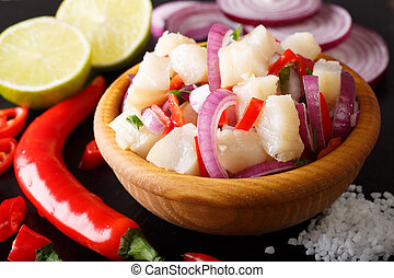 Healthy fish ceviche of cod with onion and pepper close-up...