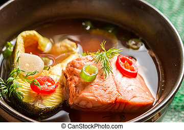Healthy fish soup made of salmon and trout