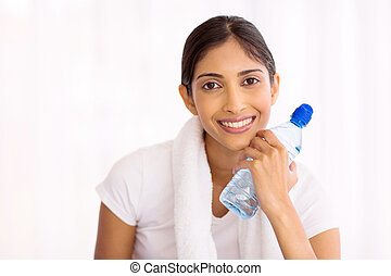 fitness indian woman with water bottle