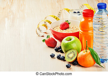 Healthy food and fitness concept. Fresh fruits, juice and cereal