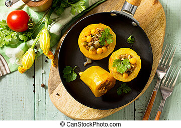 Healthy food: Baked Zucchini Stuffed - with chickpea and Meat on kitchen table. Diet menu. Top view flat lay background.
