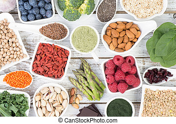 Healthy food called super foods on wooden background