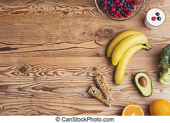 Healthy food composition on a wooden table background