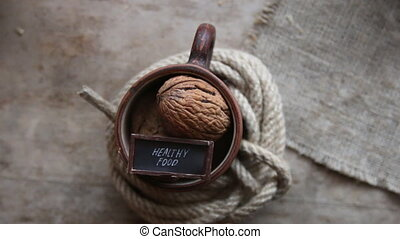 healthy food concept - walnuts on old wooden table and text...