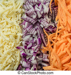 Healthy food concept. Vegetables: carrots, onions, turnip. Grated vegetable close up in the kitchen. Food concept.