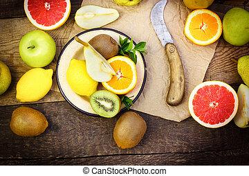 Healthy food - fresh organic fruits on table