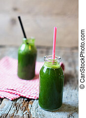 Healthy food - Fresh organic green smoothie with salad