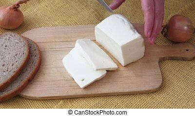 Healthy food. Goat cheese on a wooden cutting board.