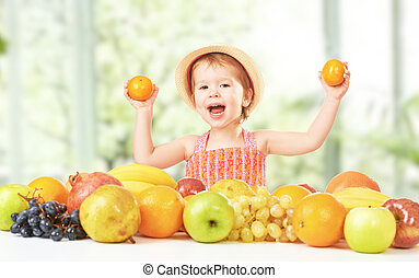 healthy food. happy child girl and a fruit